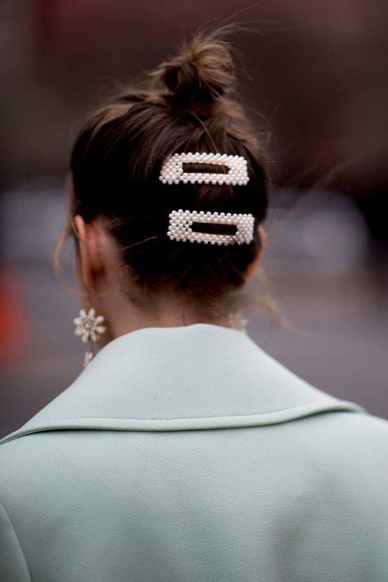 accent your top knot with trendy pearl hair clips and add a pair of statement pearl earrings