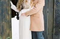 26 a white coat with a luxurious fur collar will add a refined touch and a chic feel to your bridal look