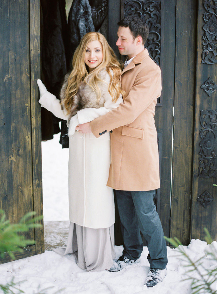 a white coat with a luxurious fur collar will add a refined touch and a chic feel to your bridal look