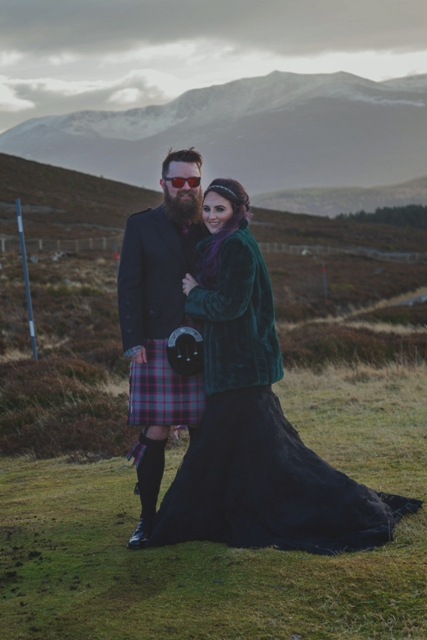 Alanna always wanted a black dress for her wedding, so she chose a sleeveless maxi one and mixed it with flat boots and an emerald faux fur jacket