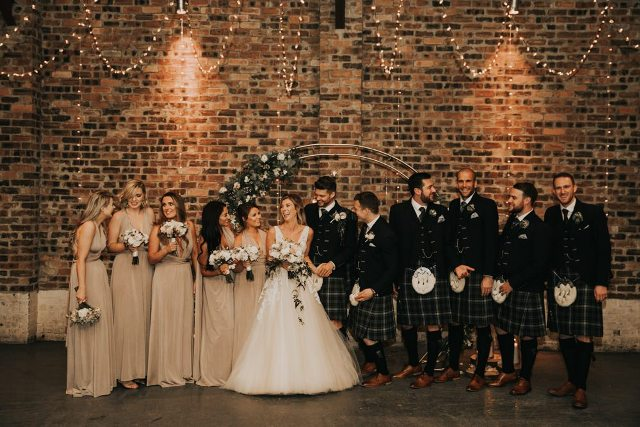 Groomsmen chose traditional kilts, tweed blazers, vests and brown shoes