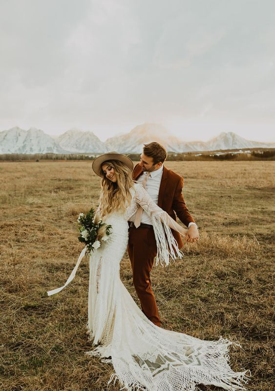 a boho bride in a sexy mermaid dress