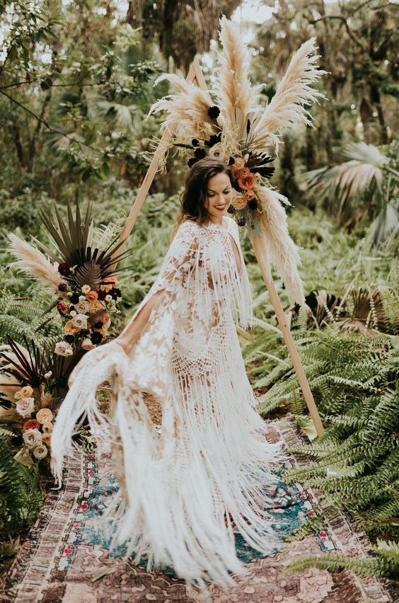 a boho lace sheath wedding gown all covered with long fringe looks very breezy and wild