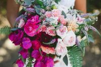 a bright ombre wedding bouquet from blush, light pink, pink and hot pink blooms, greenery and ferns just wows