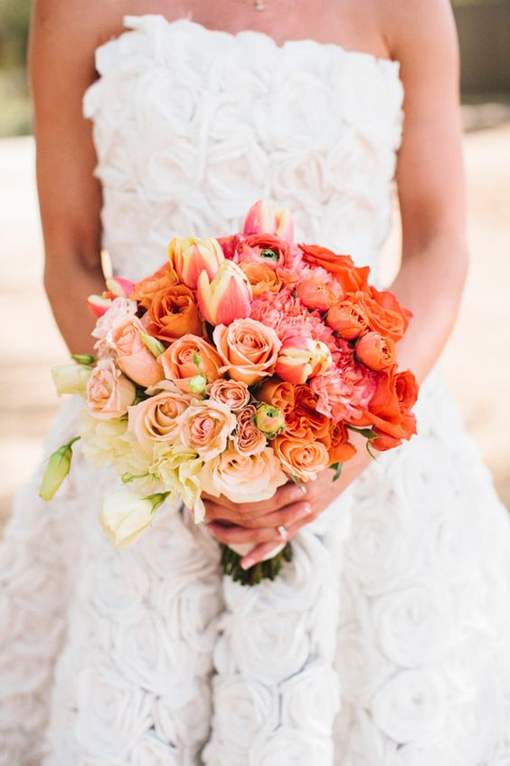 a bright ombre wedding bouquet from white to blush, pink and fiery red blooms looks statement-like