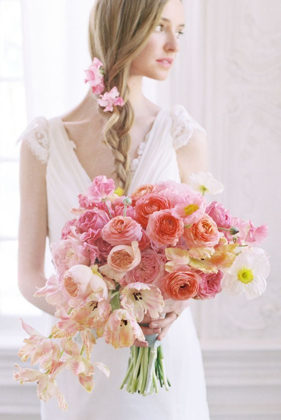 a chic obre wedding bouquet of peachy, pink, and bright pink blooms is a stylish and bold idea to rock