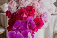 a jaw-dropping wedding bouquet from white to light pink, fuchsia and bold purple and a cascading effect is a bright idea