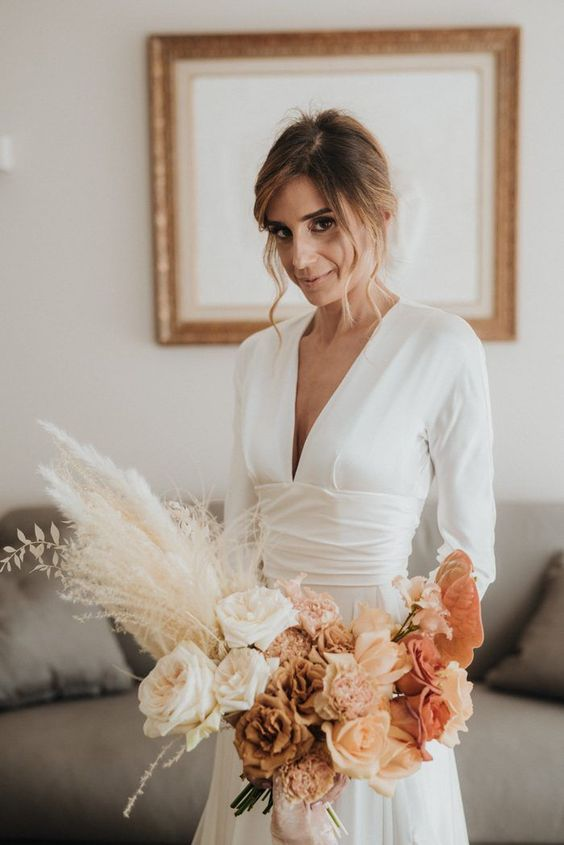 a refined modern ombre wedding bouquet from white to brown, pink and blush blooms and pampas grass