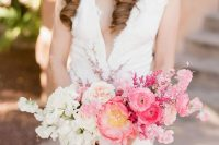 a romantic wedding bouquet from white to blush and pink, with some berries and dried twigs looks chic