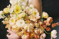 a soft pastel wedding bouquet of white, light and bolder yellow blooms and blush flowers is a chic and refined idea