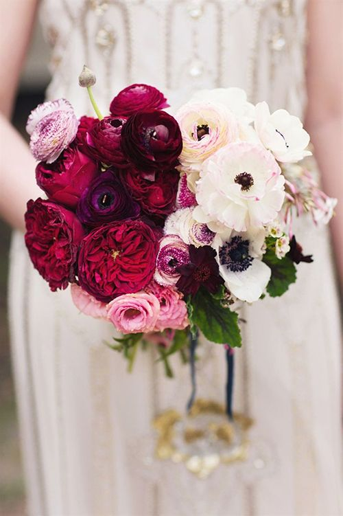 a statement ombre wedding bouquet from pink, red and deep purple to white and with some leaves