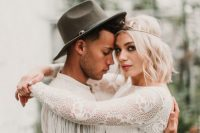 boho lace sleeves with long fringe attached look very wild and boho, which is trendy