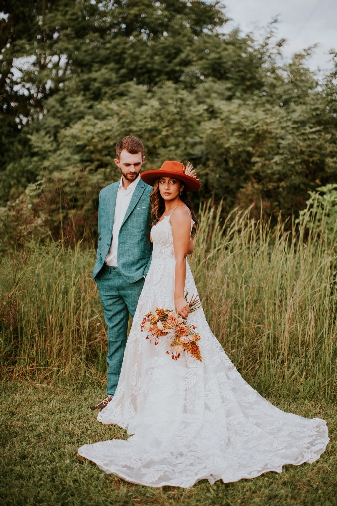 This wedding shoot showed off a very non typical color scheme   teal and terracotta, dried palms and fall boho spirit