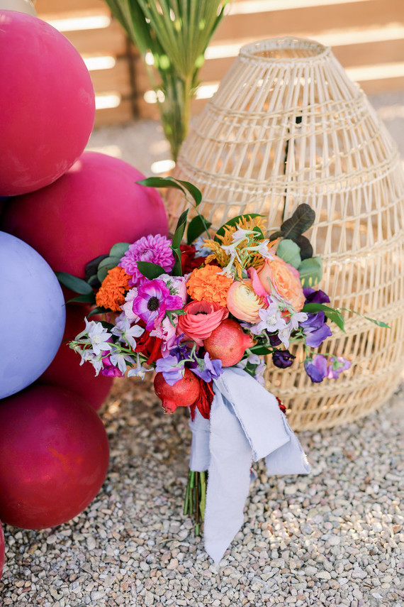 The wedding bouquet was super bright and done with not only blooms or ribbons but also pomegranates