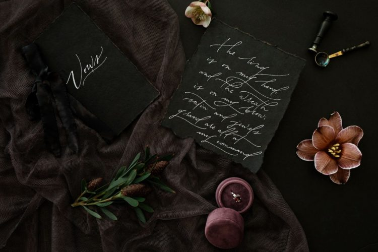 The wedding invitation suit was done in black with white calligraphy