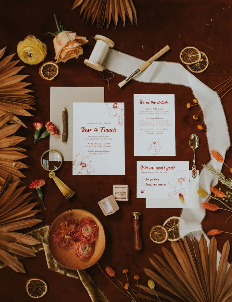 The wedding invitation suit was done in white and with burgundy letters and calligraphy