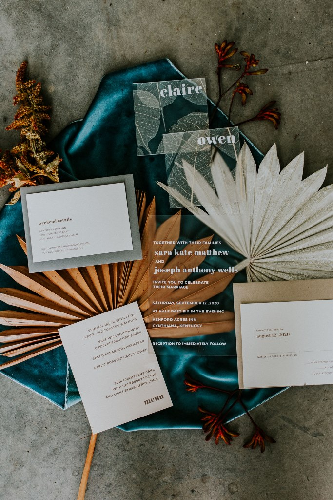 The wedding invitation suit was ultra-modern, with sheer acryl, white and grey envelopes