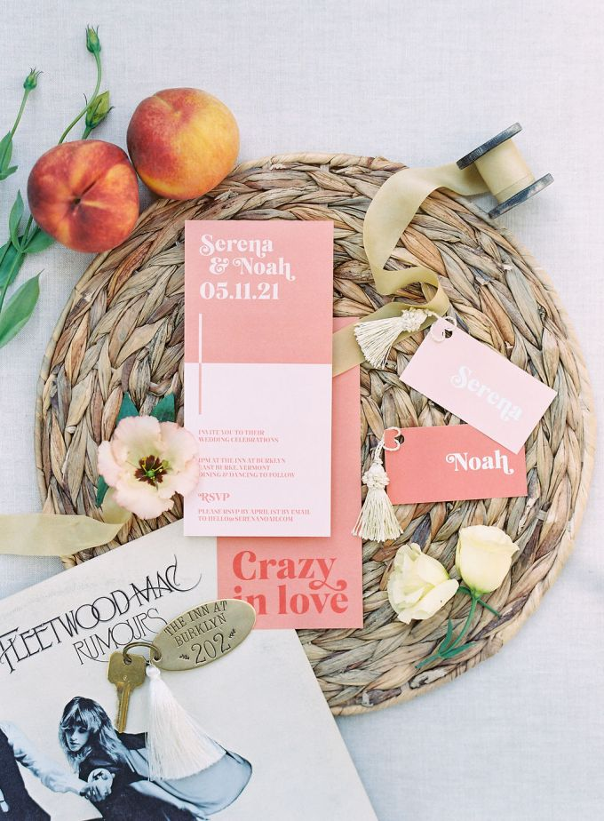 The wedding invitation suite was done in pink, coral and with bright letters