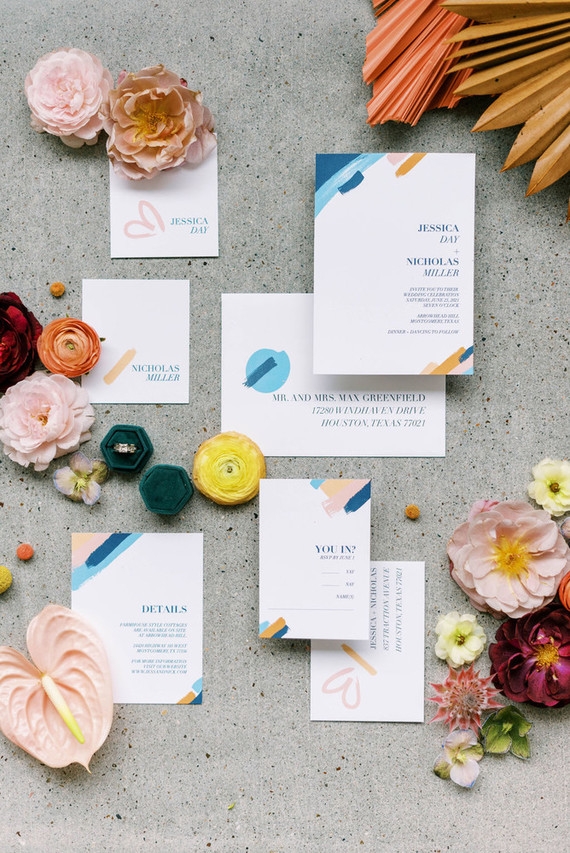 The wedding invitation suite was done with colorful brushstrokes that perfectly hinted on the color scheme of the shoot