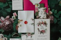 02 The wedding invitation suite with a bold pink envelope and a floral print is a lovely idea