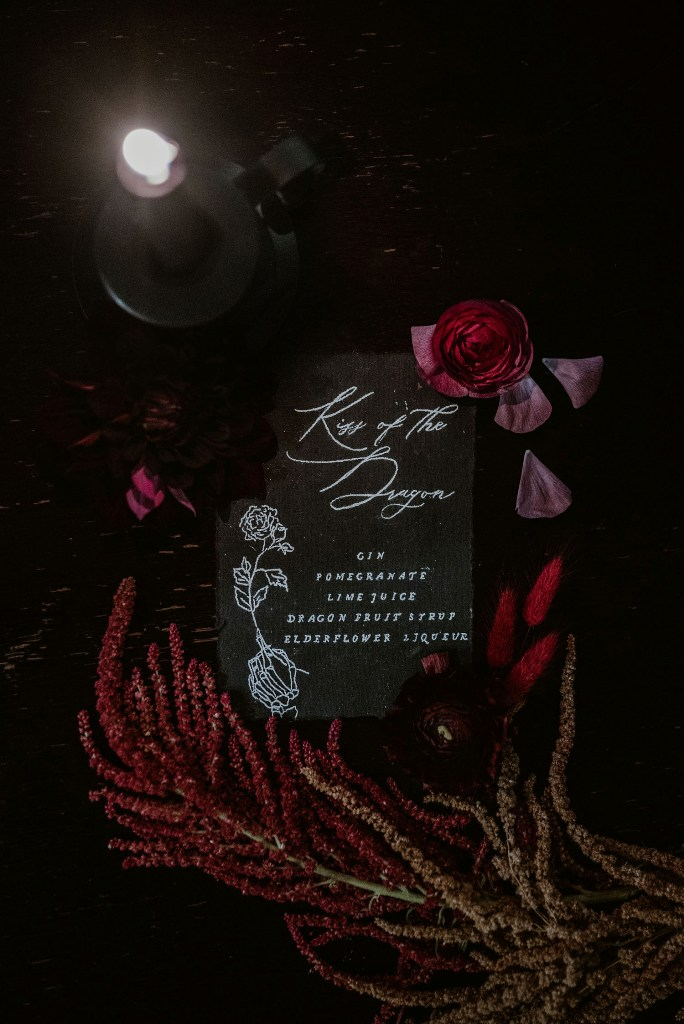 The wedding stationery was done black with white letters and with quotes from the book