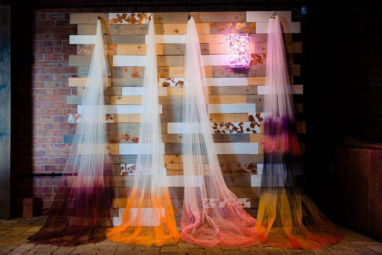 Ombre dyed veils were repurposed to decorate the space