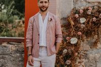 03 The groom was wearing a terrracotta blazer, a white shirt and pants and brown moccasins