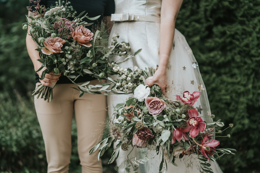 The wedding bouquets were done in pink, mauve and white and with greenery