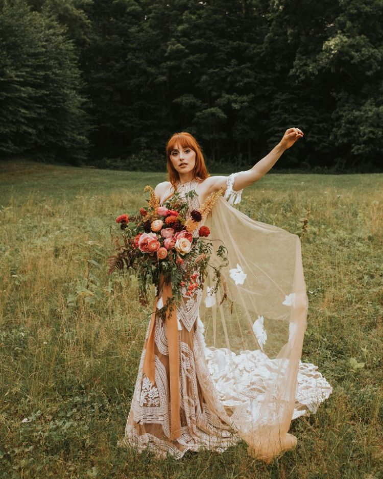 The wedding dress was a boho nude and white lace one, with a halter neckline and a train