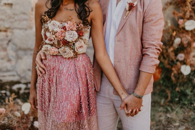 The bride rocked a pink mini skirt, a sparkling overskirt, a floral strapless bodice for a statement