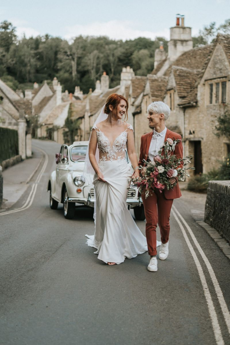 The second look was done with a rust suit, a white shirt and sneakers, a gorgeous fitting wedding dress and a veil