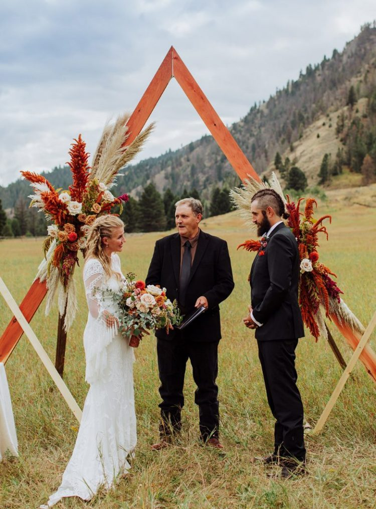 The wedding arch was a geometric one, with bold florals and bright grasses