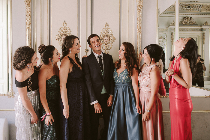 Bridesmaids were rocking mismatching pink, blush, green, navy and other embellished dresses and looked super glam and bold