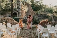 06 An alternative wedding space – castle ruins decorated with blooms and dried leaves, with white chairs that are very refined