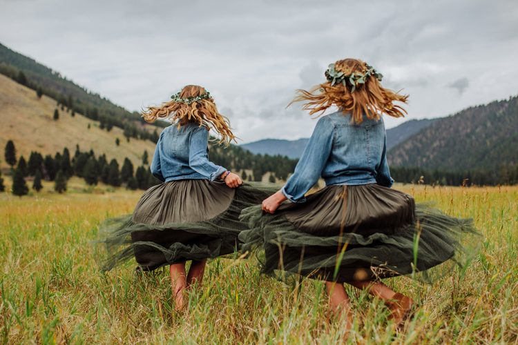 The flower girls were wearing green tulle skirts and chambray shirts for a rustic feel