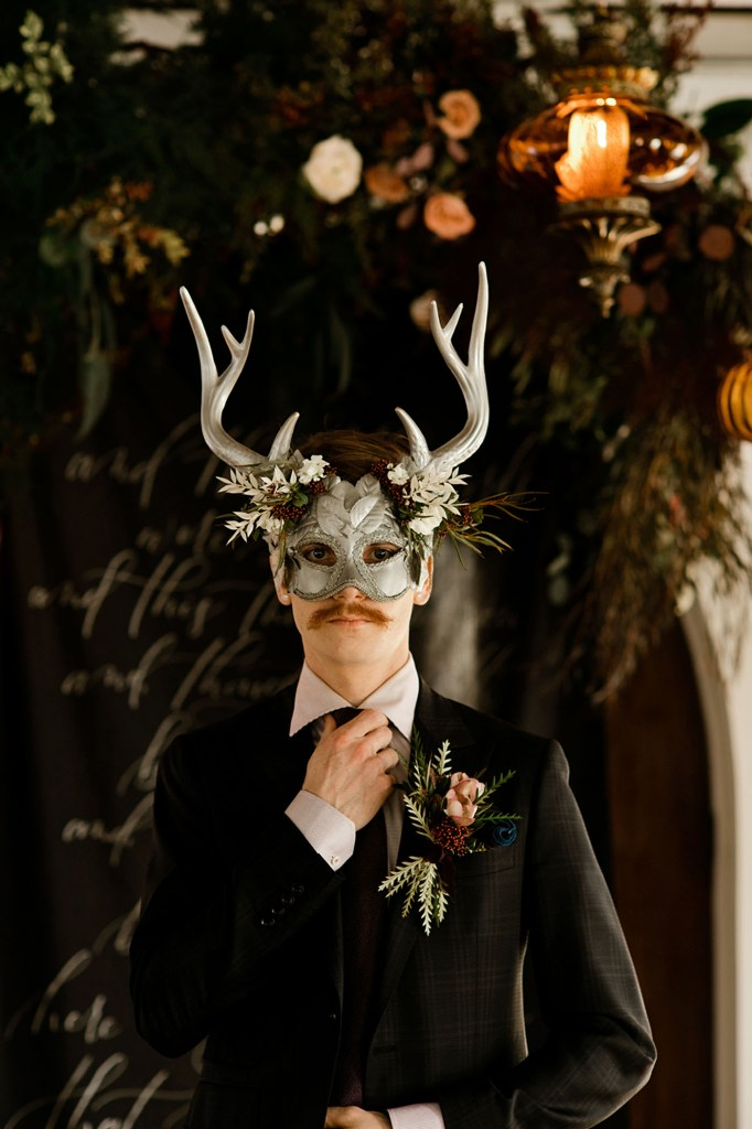 an antler mask is a nice addition to a moody wedding shoot