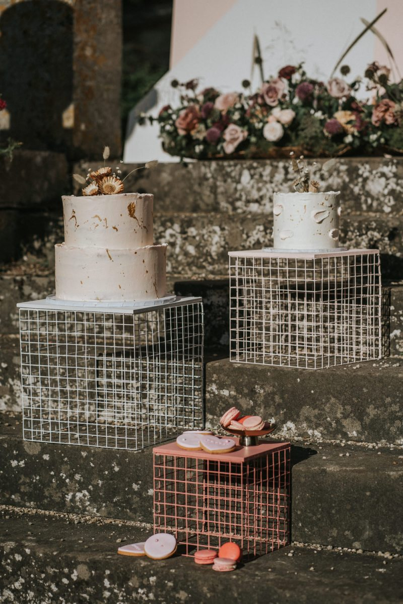 There were two gorgeous wedding cakes with brushstrokes and dried blooms and some glazed cookies
