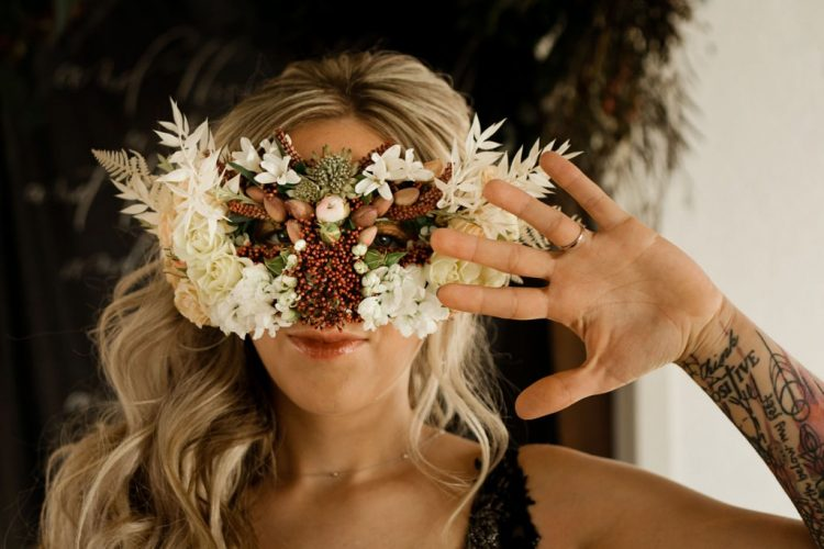 The bride was wearing a gorgeous floral, berry and nut mask that takes breath away
