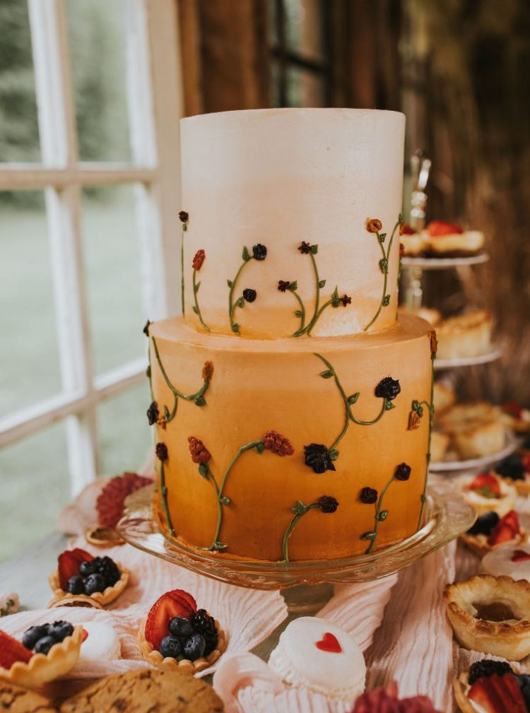 The wedding cake was an ombre rust one, with botanical patterns and there were macarons and tiny cupcakes