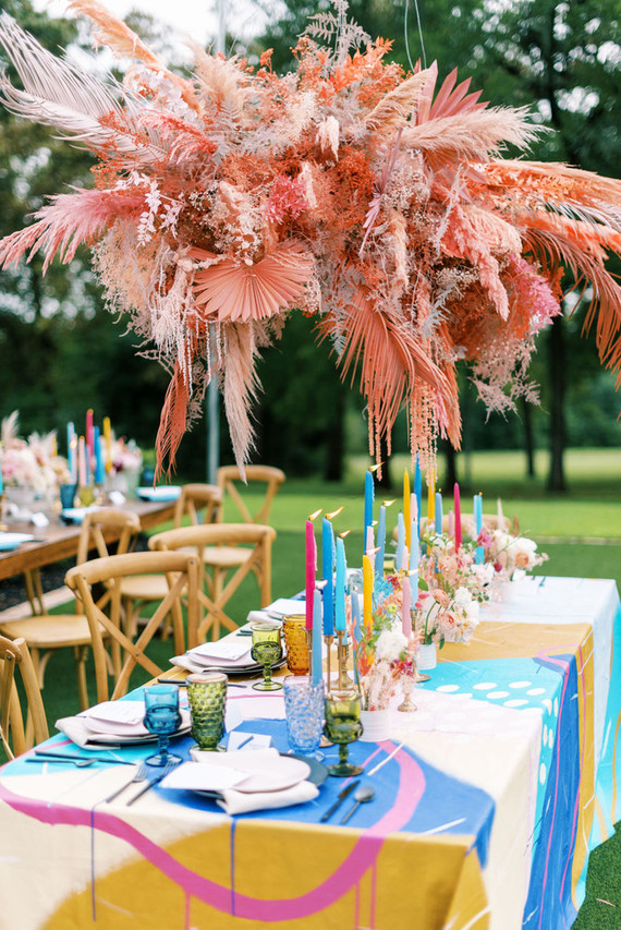 The bright overhead installation of pink blooms, fronds and grasses was a real centerpiece of the space