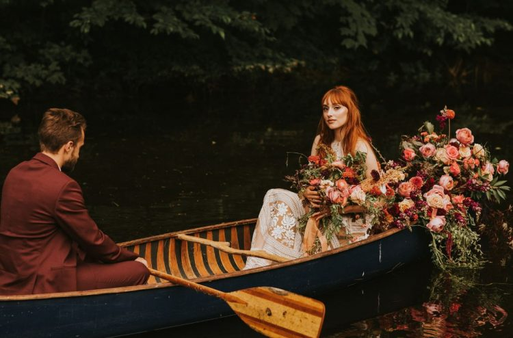 The couple took a ride in a boat decorated with lush florals and greenery for more fall romance
