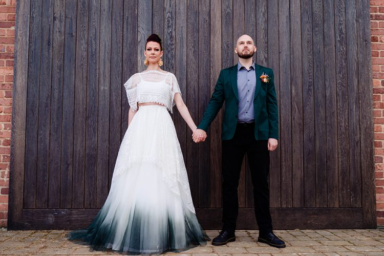 The groom was wearing a bold look with a teal blazer, a blue shirt, black pants and shoes