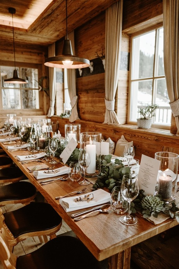 The tables were decorated with greenery runners, succulents, candles and felt very cabin like