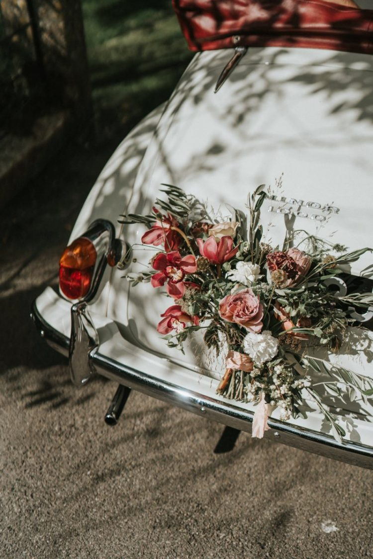 The wedding car was done with the same blush and pink blooms and greenery
