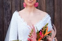 09 The wedding bouquet was done with pink, blush and orange blooms, leaves and pink pampas grass