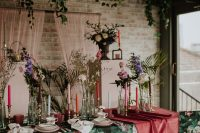 09 The wedding tablescape was jaw-dropping, with a floral tablecloth, pink runners, colorful candles, burgundy glasses and floral mugs
