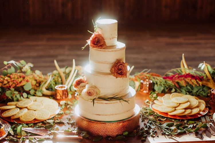The wedding cake was an elegant naked one, topped with rust and blush roses and greenery