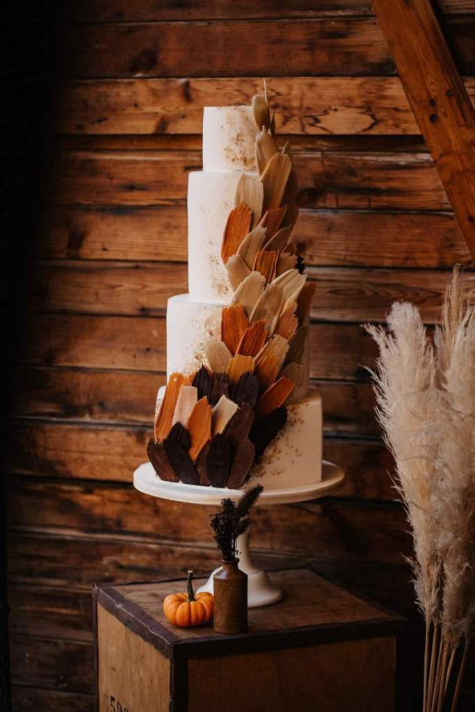 The wedding cake was decorated with colorful chocolate shards and sparkles