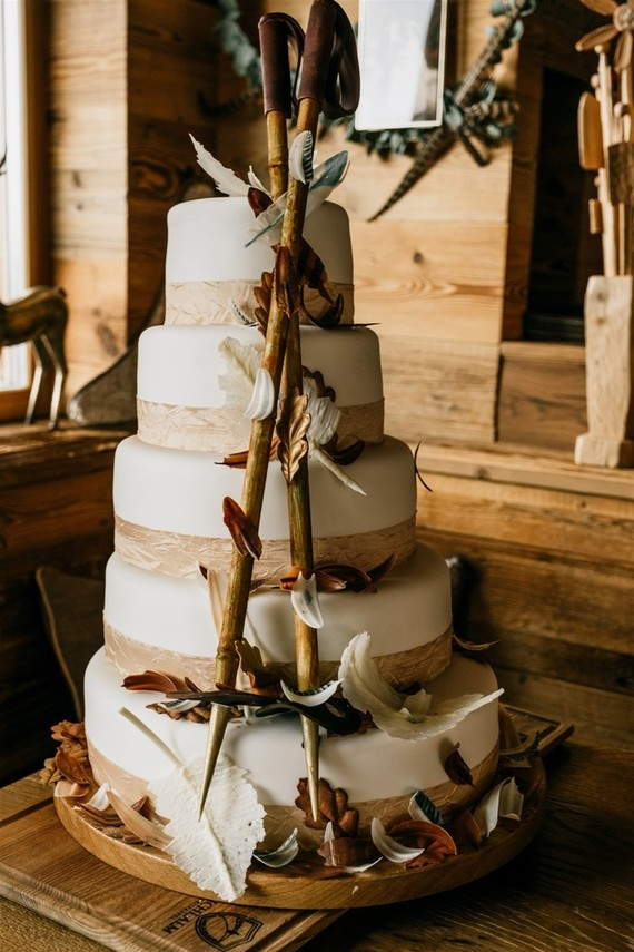 The wedding cake was decorated with faux leaves and sugar skiing sticks for fun