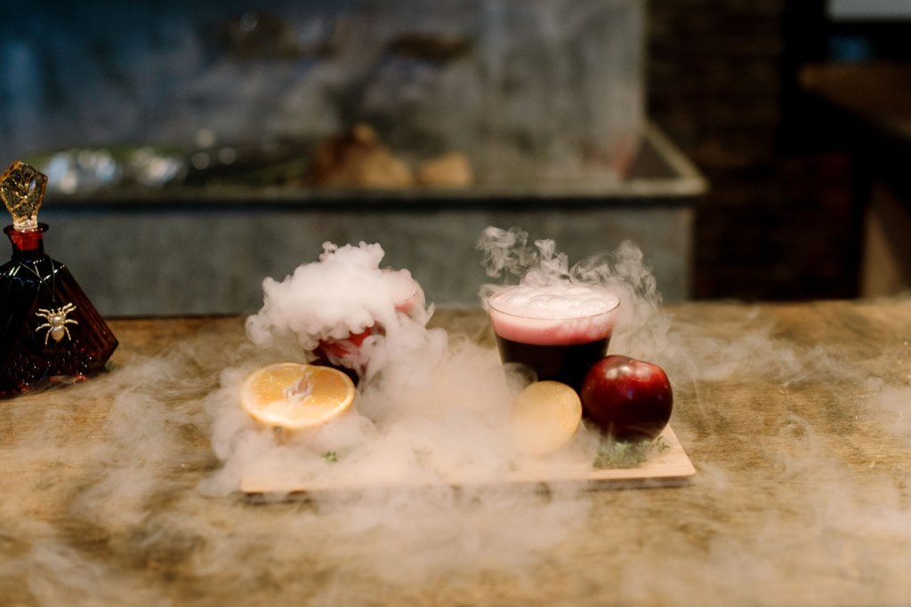 What a gorgeous idea to serve smoking and bold cocktails for a Halloween wedding